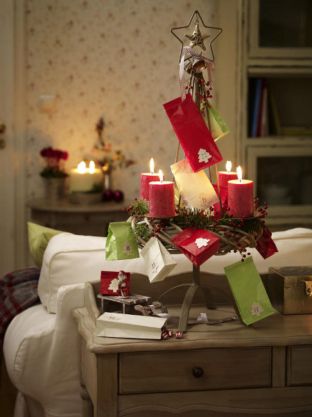festive-table-candlestick-small-colored-paper-bags-fancy-ornamental-fir-tree-motif