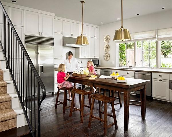 Brass pendants metallic accents in the modern kitchen interior