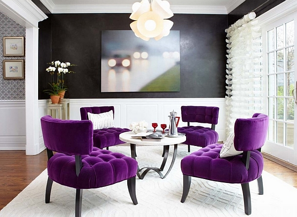 strong purple accents in sitting area contrast to black and white home decor