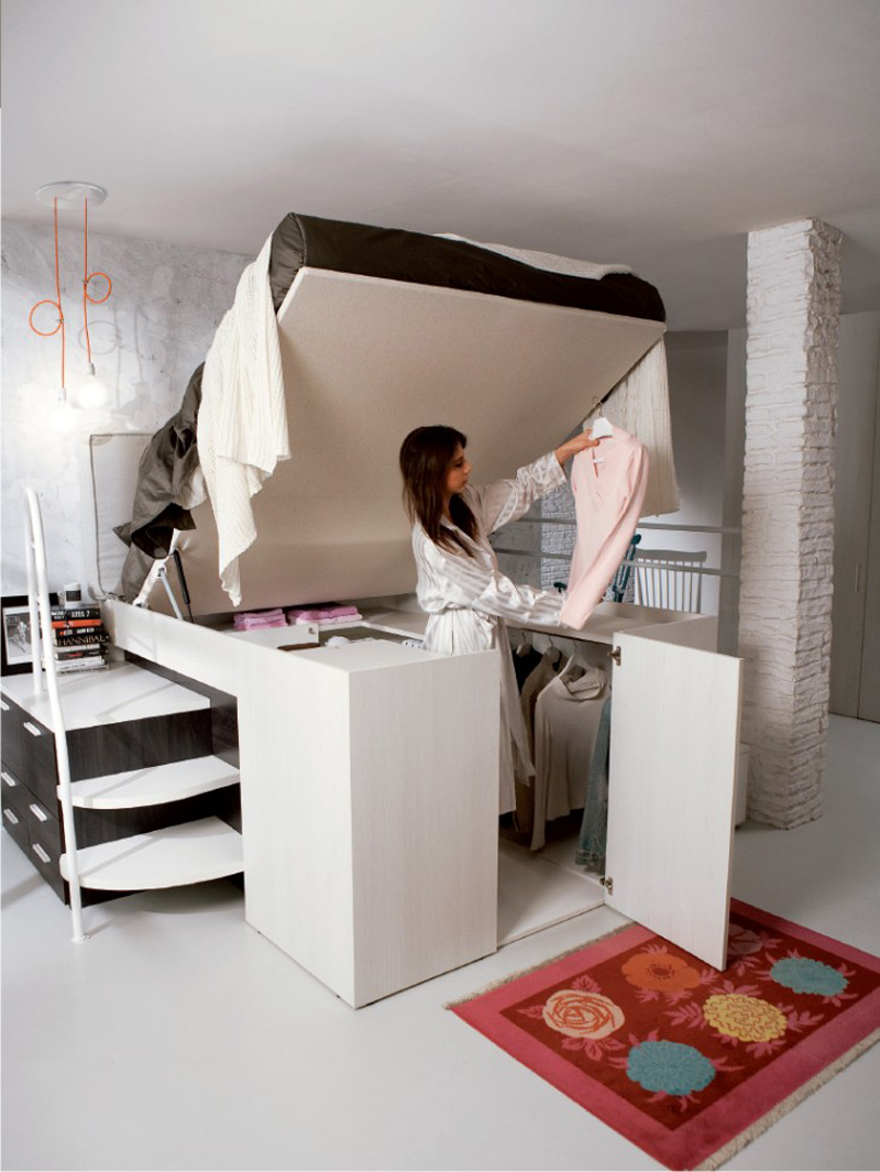 a-full-closet-is-hidden-under-this-bed-img4