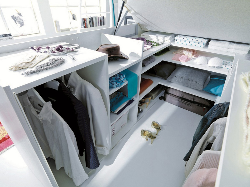 a-full-closet-is-hidden-under-this-bed-img5