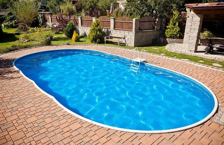 Swimming pool in your own garden so easily achieved the for Building a swimming pool in garden